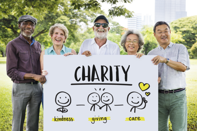 group of people holding a Charity banner